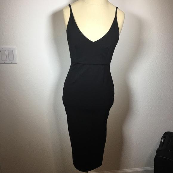 MINKPINK Dresses & Skirts - Backless Minkpink dress with thigh high slit